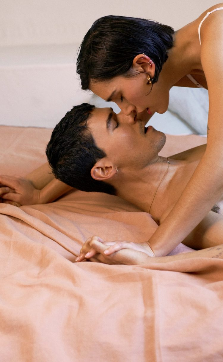 Couple kissing on the bed