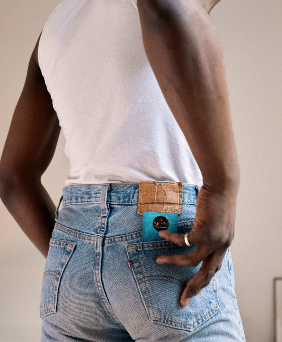 Man with SKYN Get Fresh Pocket wipes in his back pocket
