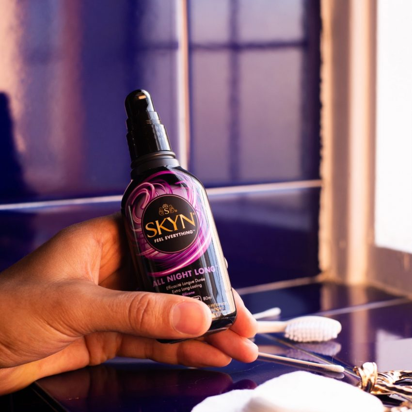 Girl hand holding a SKYN All Night Long Lubricant