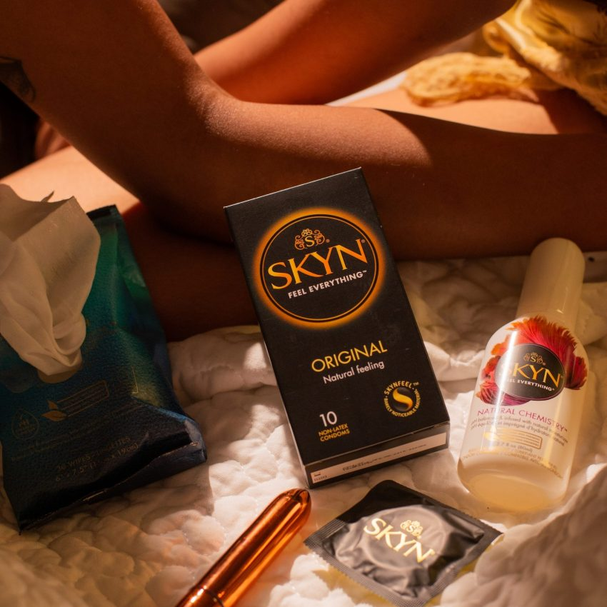 Box of SKYN condoms, lubricant and Thrill sex toy