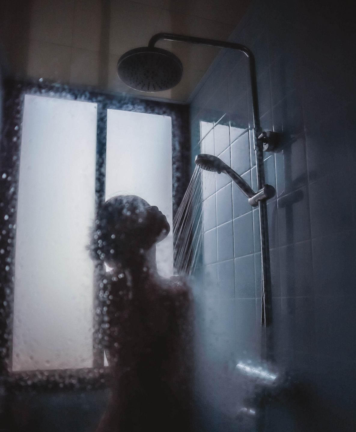 Naked girl taking a shower