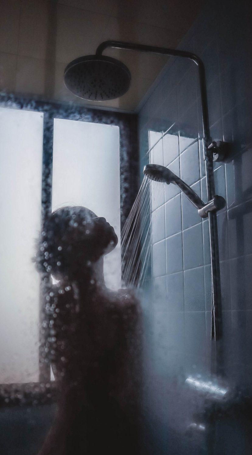 Naked girl taking a shower